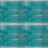 Sömlös fototextur av träplankor med blå olja någon suddighet arkivfoto