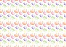 Sömlös hjärtabakgrund i marsipanfärger Royaltyfria Foton