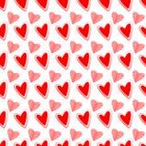 Sömlös hjärtabakgrundsrosa färger och rött Royaltyfri Foto