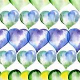 Sömlös modell av blått-, gräsplan- och gulinghjärtor Royaltyfria Foton