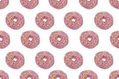 Sömlös modell av rosa färger glasade Donuts Arkivbild