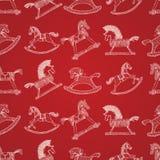 Sömlös modell för jul med att vagga hästar royaltyfri illustrationer