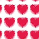 Sömlös modell för rosa hjärta på en vit bakgrund Royaltyfria Foton