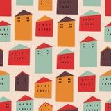 Sömlös modell för vektor med färgrika hus royaltyfri fotografi