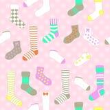 Sömlös modell för vektor med sockor i pastellfärgade färger Royaltyfria Bilder