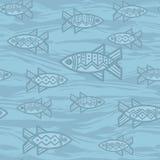 Sömlös modell i etnisk stil med fisken på blå bakgrund Royaltyfri Bild