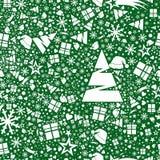 Sömlös modell i snöflingor, stjärnor, gåvor och julgranar Arkivfoto