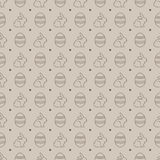 Sömlös modell med ägg och kaniner Stock Illustrationer