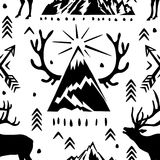 Sömlös modell med deers, horn på kronhjort och och pilar Arkivfoton