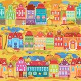 Sömlös modell med den dekorativ färgrik hus, nedgången eller höst Royaltyfri Bild