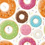 Sömlös modell med färgrika smakliga glansiga donuts Royaltyfria Foton