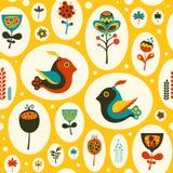 Sömlös modell med fåglar och blommor på gul bakgrund Arkivfoto