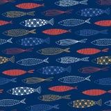 Sömlös modell med fisken på en blå bakgrund Royaltyfria Foton