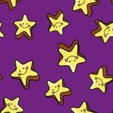 Sömlös modell med gulliga le stjärnor på blå bakgrund Arkivbilder