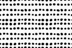 Sömlös modell med hand drog små svartprickar för klotter Arkivfoto
