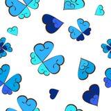 Sömlös modell med hjärtor och fjärilar Arkivfoto