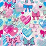 Sömlös modell med hjärtor och pilbågar rosa färger blått Arkivbild