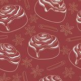 Sömlös modell med kanelbruna rullar med glasyr på kaka och kryddan Arkivbilder