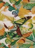 Sömlös modell med lövverk, champinjoner och fjärilar royaltyfria foton