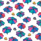 Sömlös modell med paraplyet och hatten Stock Illustrationer