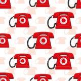 Sömlös modell med röda retro telefoner Royaltyfria Bilder