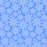 Sömlös modell med snöflingor på en blå bakgrund Royaltyfri Fotografi