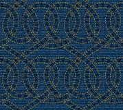 Sömlös modell som broderas på blå grov bomullstvilltexturbakgrund Arkivbild