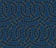 Sömlös modell som broderas på blå grov bomullstvilltexturbakgrund Royaltyfria Foton