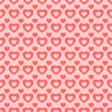 Sömlös röd och rosa hjärtabakgrund Fotografering för Bildbyråer