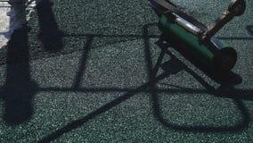 Sömlös rubber beläggning för lekplatser arkivfilmer