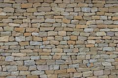 Sömlös stenvägg som göras med gamla tegelstenar royaltyfri foto