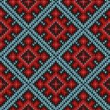 Sömlös stucken modell främst i röda och blåa toner Royaltyfri Bild
