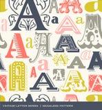 Sömlös tappningmodell av bokstaven A i retro färger Royaltyfri Bild