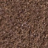Sömlös textur av brun jord. Arkivfoton