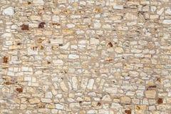 Sömlös textur av den gamla stenbeigaväggen Arkivbilder