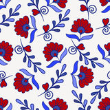 Sömlös textur med den röda och blåa moderna blomman Ändlös blom- modell för vektor Royaltyfria Foton