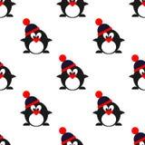 Sömlös vektormodell med djur, gullig symmetrisk bakgrund med pingvin med vinterhattar Arkivbild