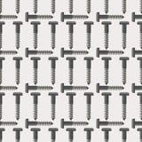 Sömlös vektormodell med hjälpmedel Symmetrisk bakgrund med skruvar på den gråa bakgrunden Royaltyfri Fotografi