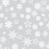Sömlös vinterbakgrund med snöflingor Arkivbild