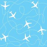 Sömlösa bakgrundsflygplan som flyger med streckat Arkivfoto