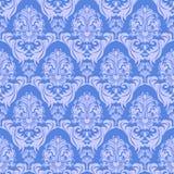 Sömlösa försiktig-blått damast tapet för design Arkivfoto