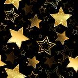 Sömlöst med guld- stjärnor Arkivbild