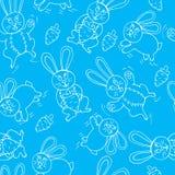 Sömlöst tryck av gulliga kaniner arkivfoto