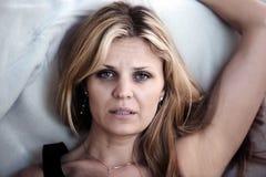 sömnlös kvinna Arkivfoto