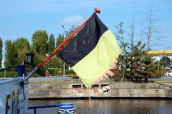 Sönderriven belgisk flagga Fotografering för Bildbyråer