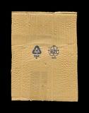 Sönderriven papp och symboler Arkivbilder