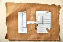 Sönderriven papp och symboler Arkivbild