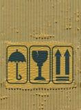 Sönderriven papp och symboler Royaltyfri Bild