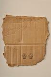 Sönderriven papp och symboler Royaltyfria Bilder