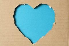 Sönderriven pappers- hjärta Arkivbild